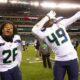NFL- football players from seahawks and eagles celebrating