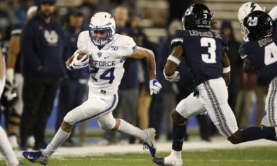 Football player running out of bounce, Airforce Falcons Vs Utah State Aggies.